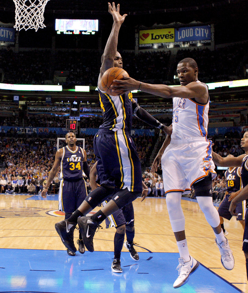 Photo - Oklahoma City's Kevin Durant (35) passes the ball around Utah's Paul Millsap (24) during an NBA game between the Oklahoma City Thunder and the Utah Jazz at Chesapeake Energy Arena in Oklahoma CIty, Tuesday, Feb. 14, 2012. Photo by Bryan Terry, The Oklahoman