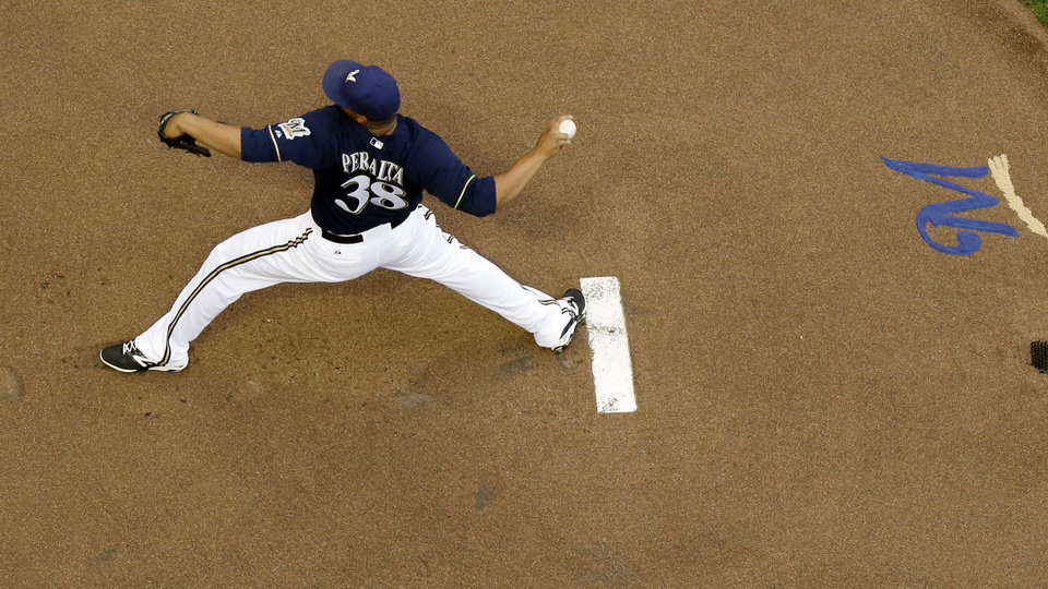 Photo - Milwaukee Brewers starting pitcher Wily Peralta throws during the first inning of a baseball game against the Cincinnati Reds Monday, July 21, 2014, in Milwaukee. (AP Photo/Morry Gash)