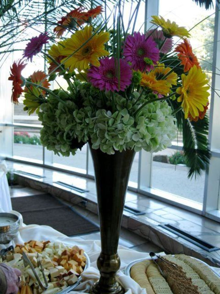 THE BRIDE AND GROOM...Beautiful flowers decorated the buffet table.   (Photo by Helen Ford Wallace)