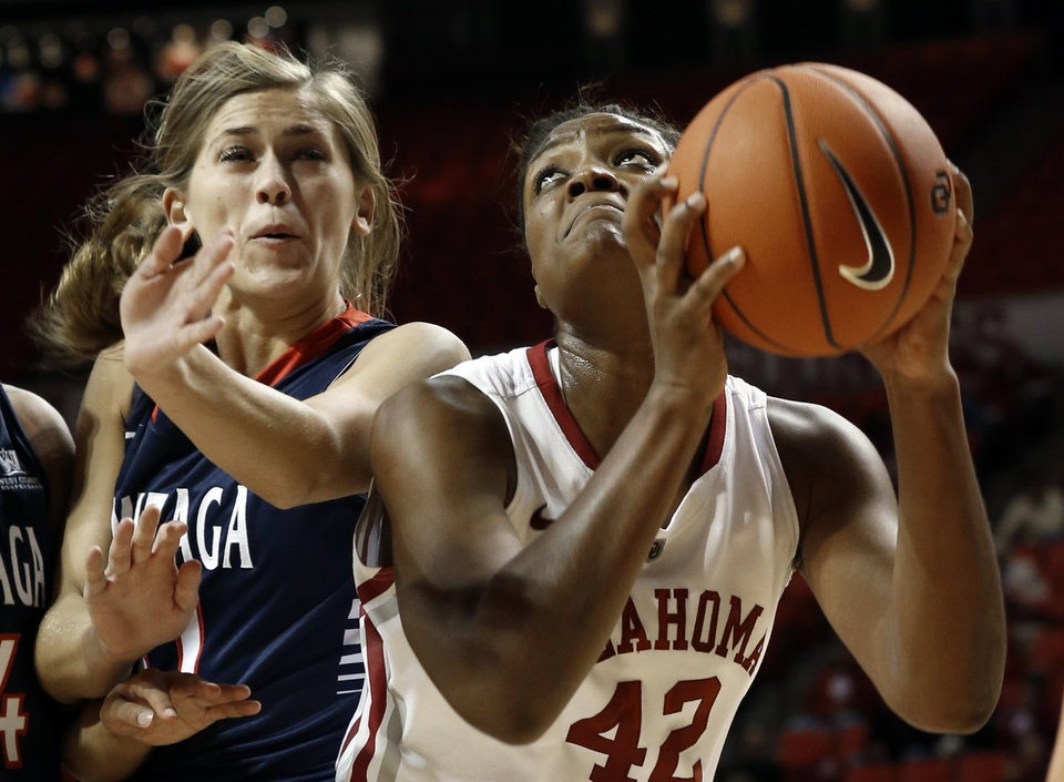 Photo - Gonzaga's Elle Tinkle (31) tries to cover Oklahoma Sooner's Kaylon Williams (42) as the University of Oklahoma Sooners (OU) play the Gonzaga Bulldogs in NCAA, women's college basketball at The Lloyd Noble Center on Thursday, Nov. 14, 2013  in Norman, Okla. Photo by Steve Sisney, The Oklahoman