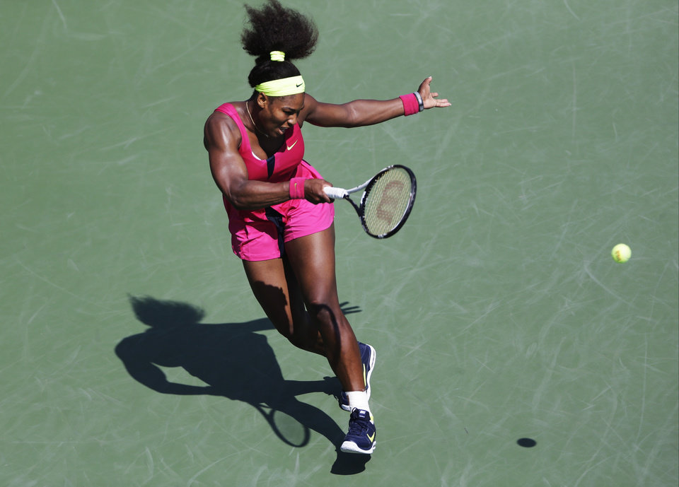 Photo -   Serena Williams returns a shot to Russia's Ekaterina Makarova in the third round of play at the 2012 US Open tennis tournament, Saturday, Sept. 1, 2012, in New York. (AP Photo/Mike Groll)