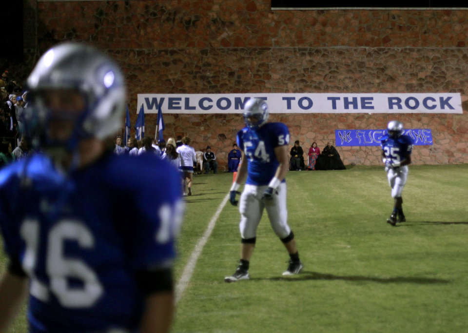 JELSMA STADIUM / THE ROCK / STADIUM / HIGH SCHOOL FOOTBALL: Guthrie players walk toward the sideline after a team huddle before they played Western Heights in Guthrie on Friday, Oct. 28, 2011. Photo by John Clanton, The Oklahoman ORG XMIT: KOD