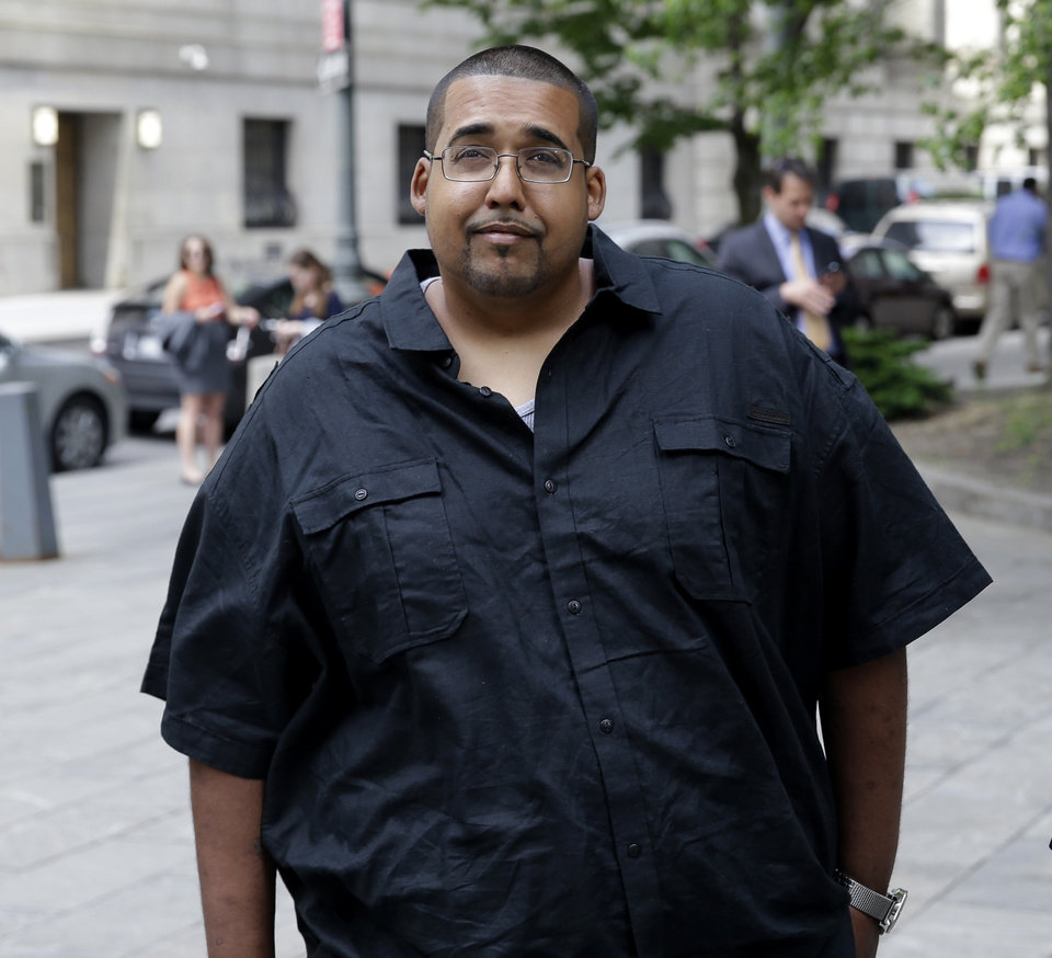 Photo - Hector Xavier Monsegur arrives at court in New York for a sentencing hearing Tuesday, May 27, 2014. Monsegur, a prolific computer hacker who infiltrated the servers of major corporations, later switched sides to helped the U.S. government disrupt hundreds of cyberattacks on Congress, NASA and other sensitive targets, according to federal prosecutors. After his arrest and guilty plea in 2011, he faced more than two decades behind bars. But because of his cooperation, the sentence could be two years or less.  (AP Photo/Seth Wenig)
