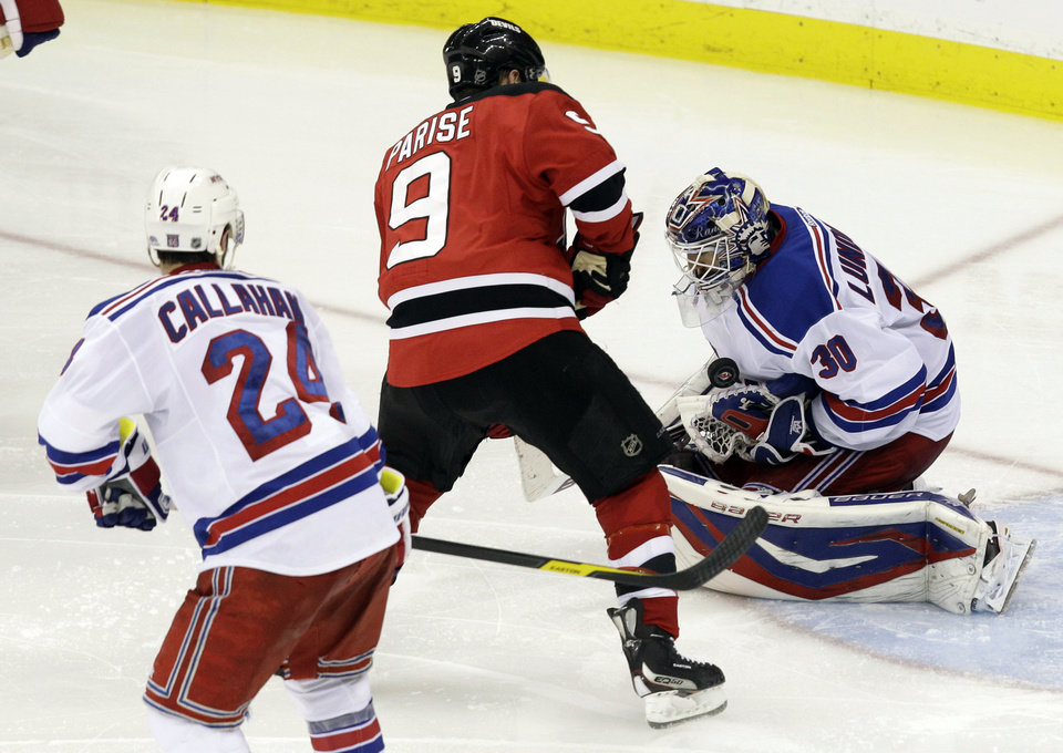 Photo -   New York Rangers goalie Henrik Lundqvist (30), of Sweden, tries to control the puck as New Jersey Devils' Zach Parise (9) approaches during the third period of Game 4 of an NHL hockey Stanley Cup Eastern Conference final playoff series, Monday, May 21, 2012, in Newark, N.J. Rangers' Ryan Callahan is at left. (AP PhotoKathy Willens)