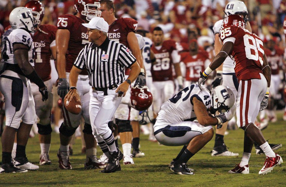 Photo - Utah State's Kyle Gallagher (43) reacts after the 31-24 loss to Oklahoma in the college football game between the University of Oklahoma Sooners (OU) and Utah State University Aggies (USU) at the Gaylord Family-Oklahoma Memorial Stadium on Saturday, Sept. 4, 2010, in Norman, Okla.   Photo by Chris Landsberger, The Oklahoman