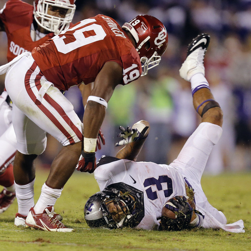 Photo - TCU 's Brandon Carter (3) reacts after being brought down by Oklahoma's Eric Striker (19) during the college football game between the University of Oklahoma Sooners (OU) and the Texas Christian University Horned Frogs (TCU) at the Gaylord Family-Oklahoma Memorial Stadium on Saturday, Oct. 5, 2013 in Norman, Okla.   Photo by Chris Landsberger, The Oklahoman
