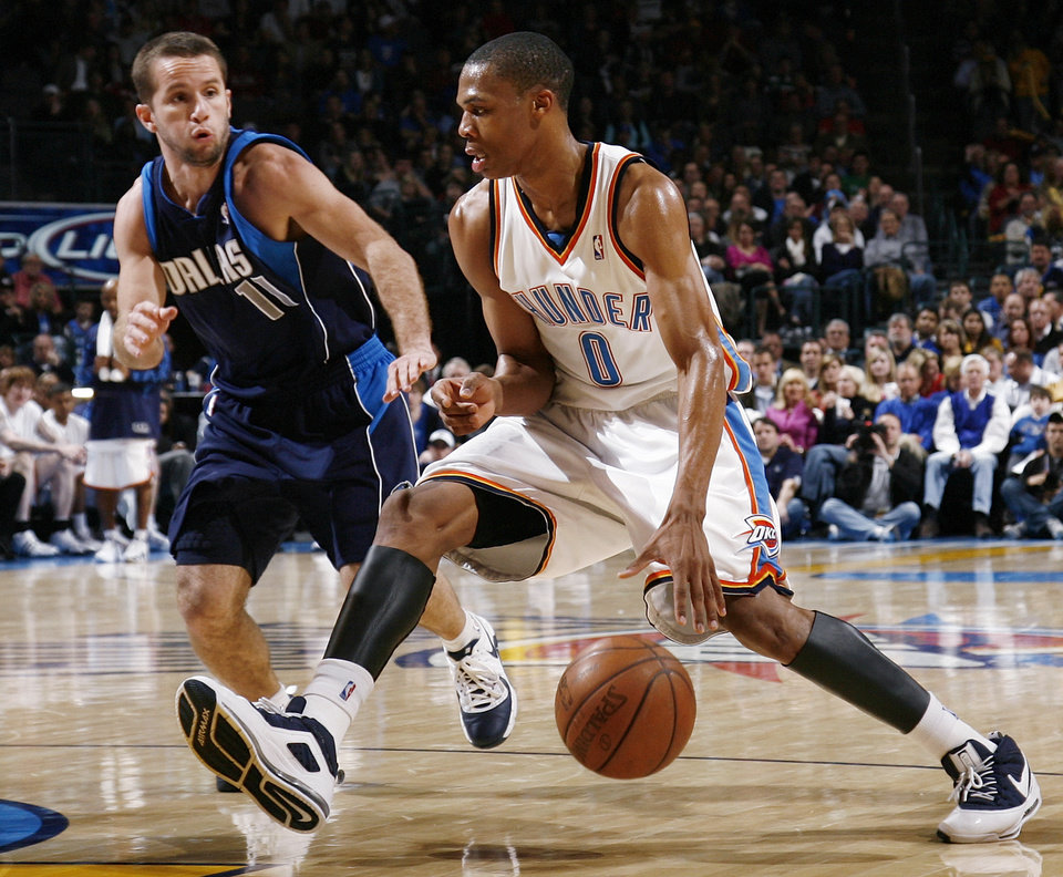 Russell Westbrook (0) of Oklahoma City drives past Jose Barea (11) of Dallas in the second half of the NBA basketball game between the Dallas Mavericks and the Oklahoma City Thunder at the Ford Center in Oklahoma City, March 2, 2009. The Thunder won 96-87. BY NATE BILLINGS, THE OKLAHOMAN
