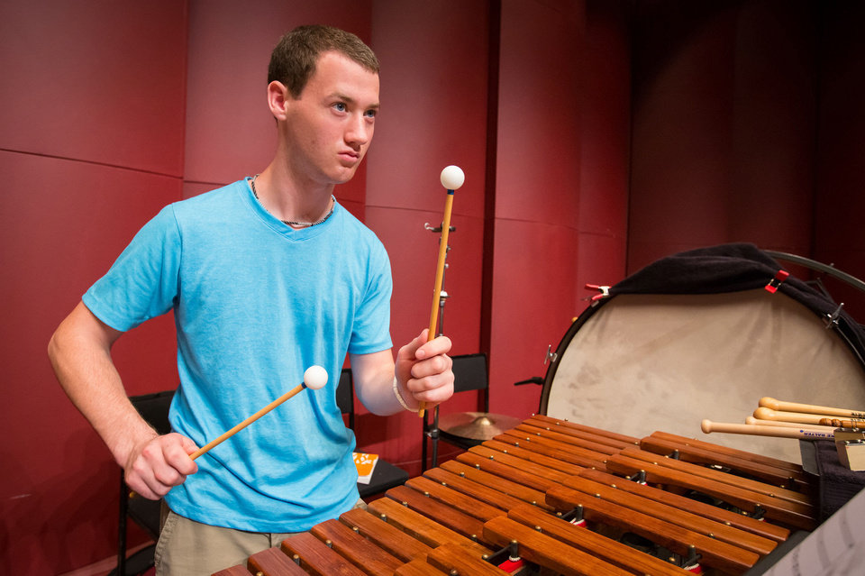 Photo - Percussionist Micheal Barnes, a member of the 2013 National Youth Orchestra of the United States of America in rehearsal.   Photo by Chris Lee  Chris Lee - Photo by Chris Lee