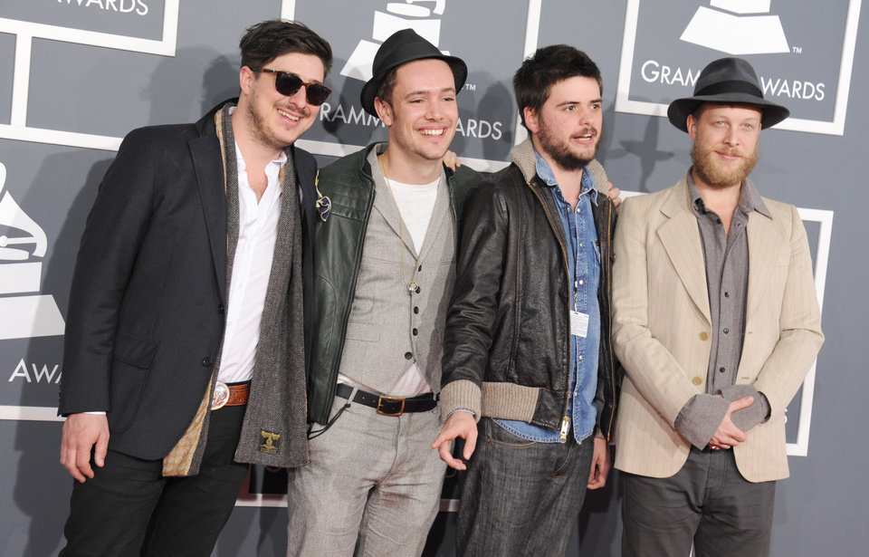 Photo - From left, Marcus Mumford, Ben Lovett, Country Winston and Ted Dwane, of musical group Mumford & Sons, arrive at the 55th annual Grammy Awards on Sunday, Feb. 10, 2013, in Los Angeles.  (Photo by Jordan Strauss/Invision/AP)