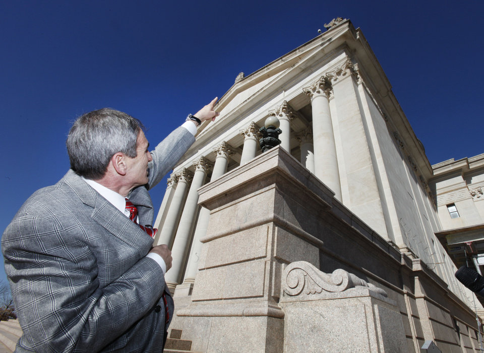 DETERIORATE / DETERIORATION / STATE CAPITOL BUILDING / GOV. MARY FALLIN / TOUR: Architect Duane Mass points at pieces of the exterior that have fallen off  during a tour of deteriorating areas of state Capitol, Thursday, January 17, 2013.  Photo By David McDaniel/The Oklahoman