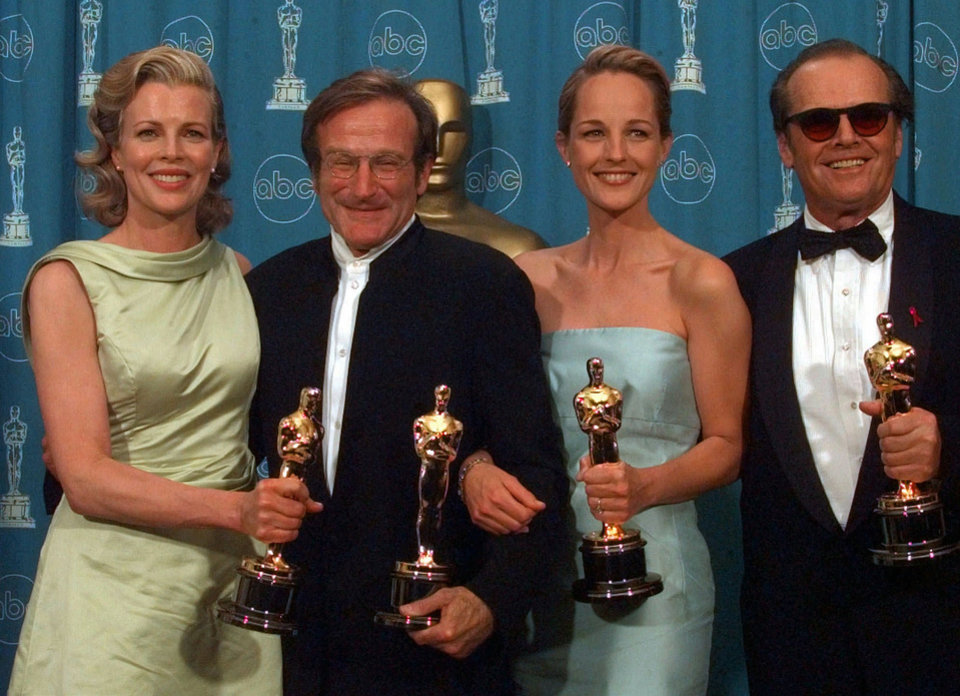 "Photo - Kim Basinger, Robin Williams, Helen Hunt and Jack Nicholson, from left to right, pose with their Oscars at the Shrine Auditorium in Los Angeles, Monday, March 23, 1998.   Basinger and Williams won Best Supporting Actress and Actor, for ""L.A. Confidential"" and ""Good Will Hunting"" respectively, Hunt and Nicholson won Best Actress and Actor, both for ""As Good As It Gets."" (AP Photo/Reed Saxon)"