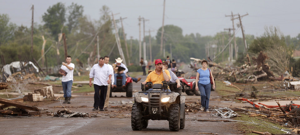 Residents walk down Drexel as they leave their homes that were destroyed after the tornado hit the area near 149th and Drexel on Monday, May 20, 2013 in Oklahoma City, Okla.  Photo by Chris Landsberger, The Oklahoman