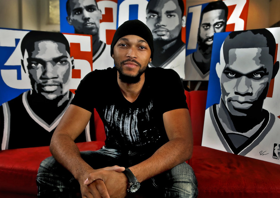 Ray Tennyson, who graduated from Midwest City High School, has made a full-time job out of his art after his Thunder paintings became popular. Photo by Chris Landsberger, The Oklahoman