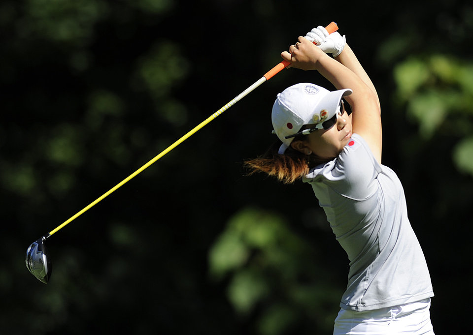 Photo - Mika Miyazato, of Japan, drives off the second hole during the second round of the International Crown golf tournament Friday, July 25, 2014, in Owings Mills, Md. (AP Photo/Gail Burton)