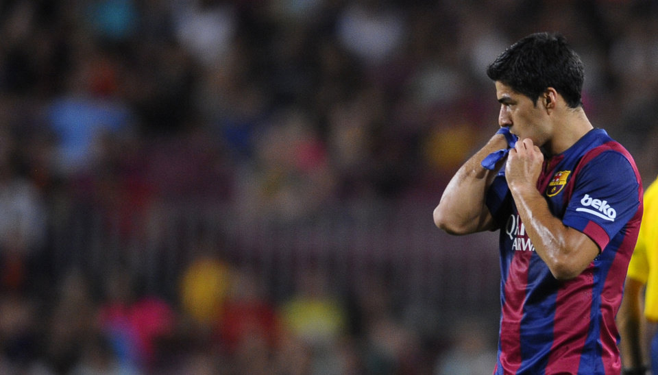 Photo - Barcelona's Luis Suarez, from Uruguay, gestures during the Joan Gamper trophy friendly soccer match against Leon at the Camp Nou in Barcelona, Spain, Monday, Aug. 18, 2014. (AP Photo/Manu Fernandez)