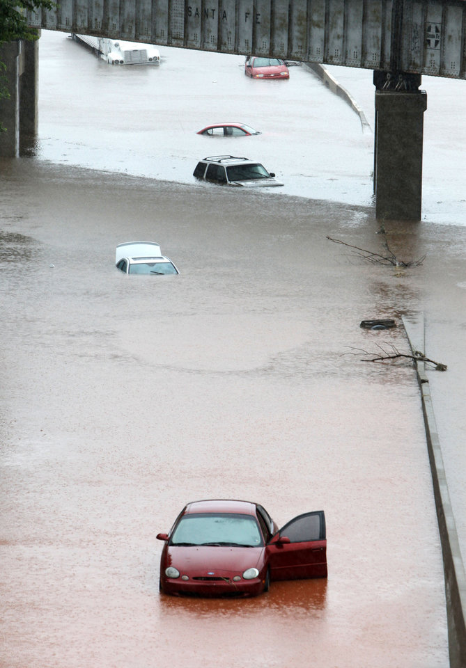Photo - Cars are almost covered in water under the railroad bridge at the Broadway Extension in Oklahoma City, OK, Monday, June 14, 2010. By Paul Hellstern, The Oklahoman