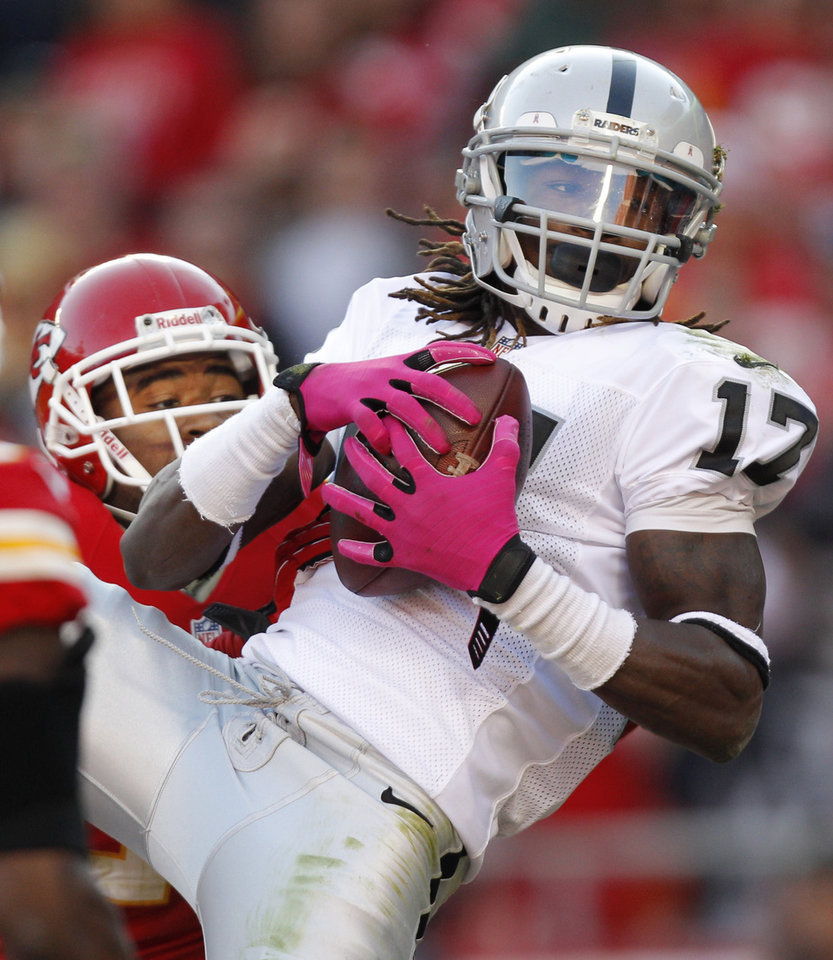 Photo -   Oakland Raiders wide receiver Denarius Moore (17) catches a touchdown pass in front of Kansas City Chiefs cornerback Stanford Routt during the first half of an NFL football game at Arrowhead Stadium in Kansas City, Mo., Sunday, Oct. 28, 2012. (AP Photo/Ed Zurga)