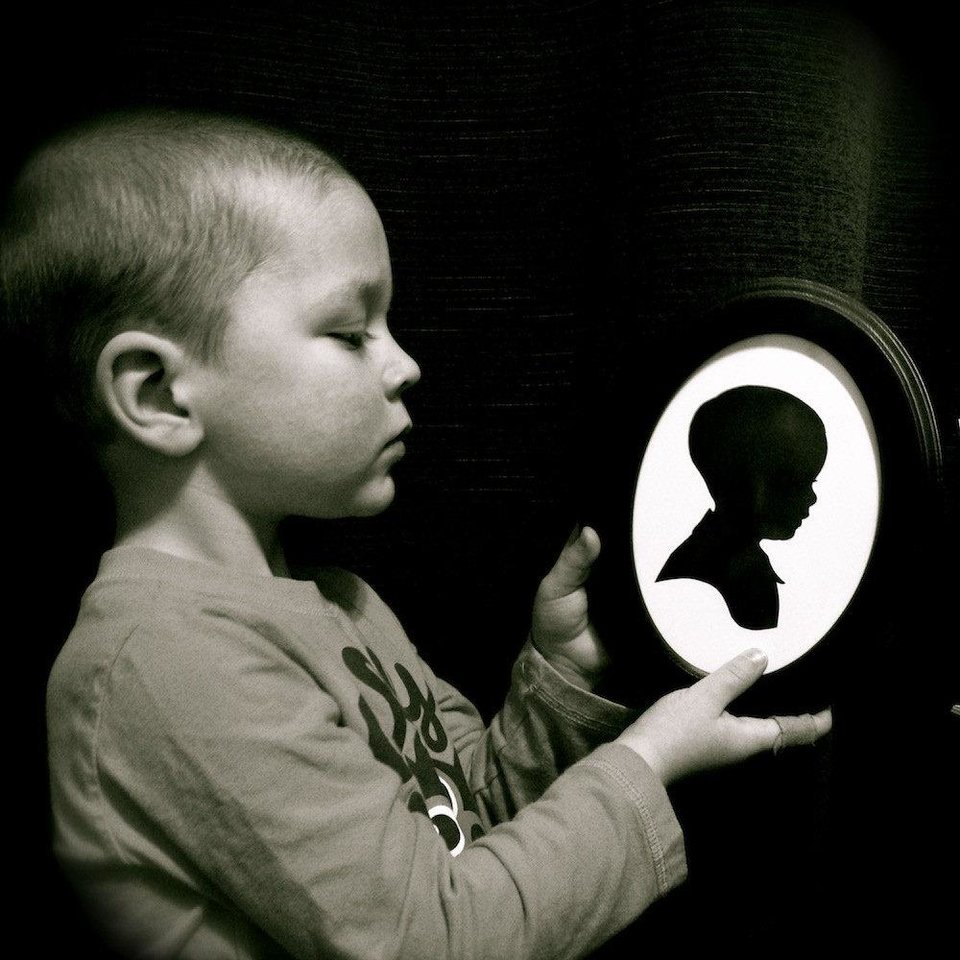 Photo -  A child holds a silhouette cutout created by artist Karl Johnson. Photo provided.