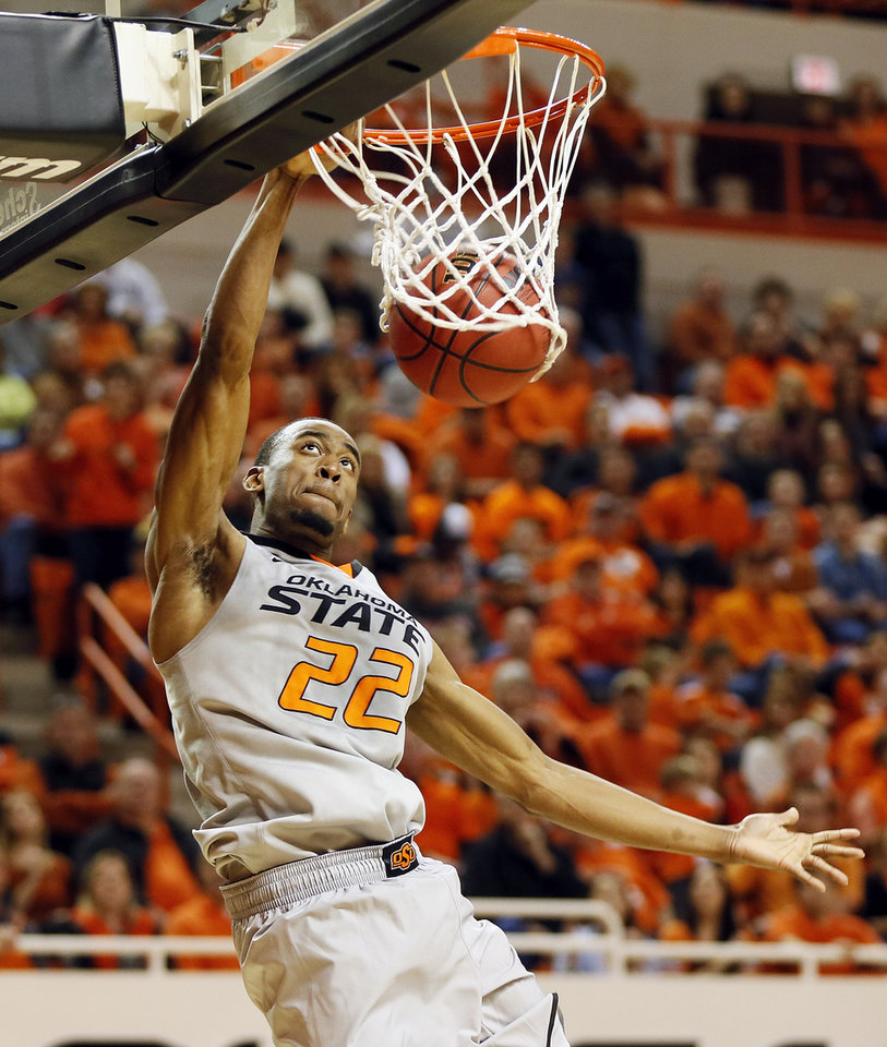 Photo - Oklahoma State's Markel Brown (22) dunks the ball during a men's college basketball game between Oklahoma State University (OSU) and Gonzaga at Gallagher-Iba Arena in Stillwater, Okla., Monday, Dec. 31, 2012. Photo by Nate Billings, The Oklahoman