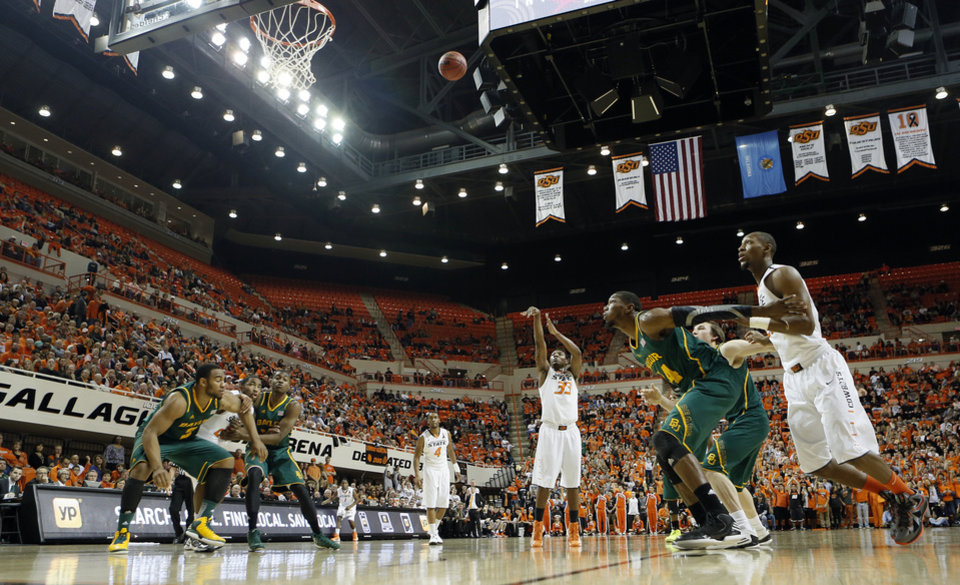 Oklahoma State 's Marcus Smart (33) shoots a free throw during the college basketball game between the Oklahoma State University Cowboys (OSU) and the Baylor University Bears (BU) at Gallagher-Iba Arena on Wednesday, Feb. 5, 2013, in Stillwater, Okla. Photo by Chris Landsberger, The Oklahoman