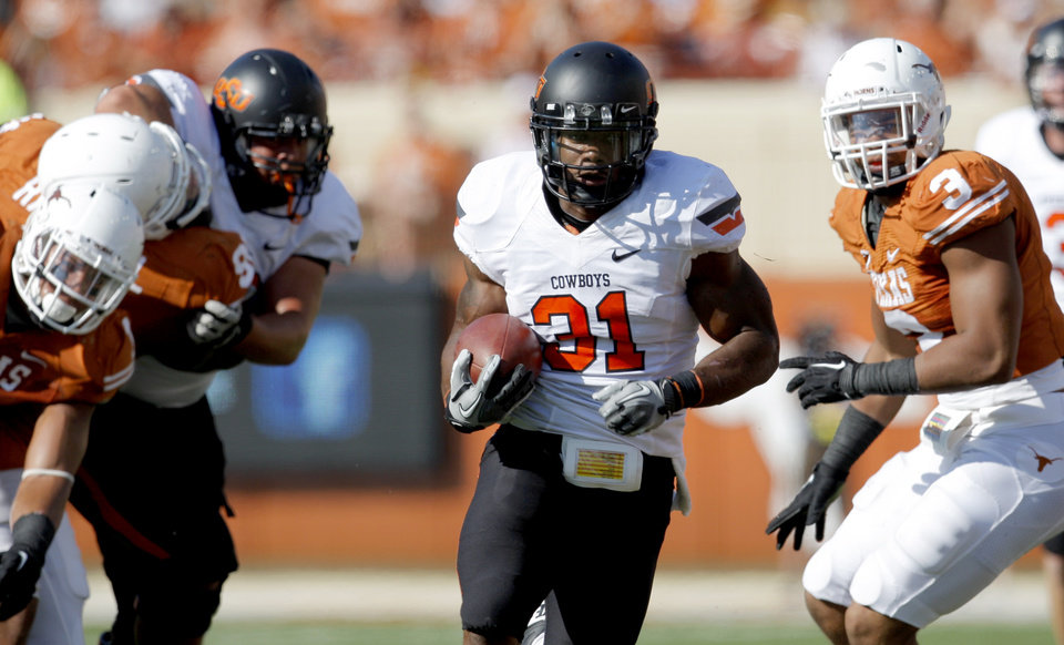 Oklahoma State's Jeremy Smith (31) gets by the Texas defense during first half of a college football game between the Oklahoma State University Cowboys (OSU) and the University of Texas Longhorns (UT) at Darrell K Royal-Texas Memorial Stadium in Austin, Texas, Saturday, Oct. 15, 2011. Photo by Sarah Phipps, The Oklahoman