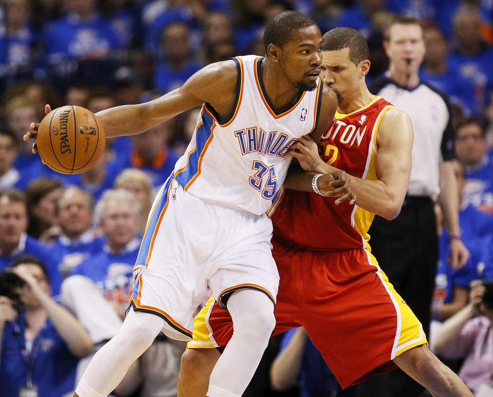 Oklahoma City's Kevin Durant (35) works against Houston's Francisco Garcia (32) in the first half during Game 5 in the first round of the NBA playoffs between the Oklahoma City Thunder and the Houston Rockets at Chesapeake Energy Arena in Oklahoma City, Wednesday, May 1, 2013. Photo by Nate Billings, The Oklahoman