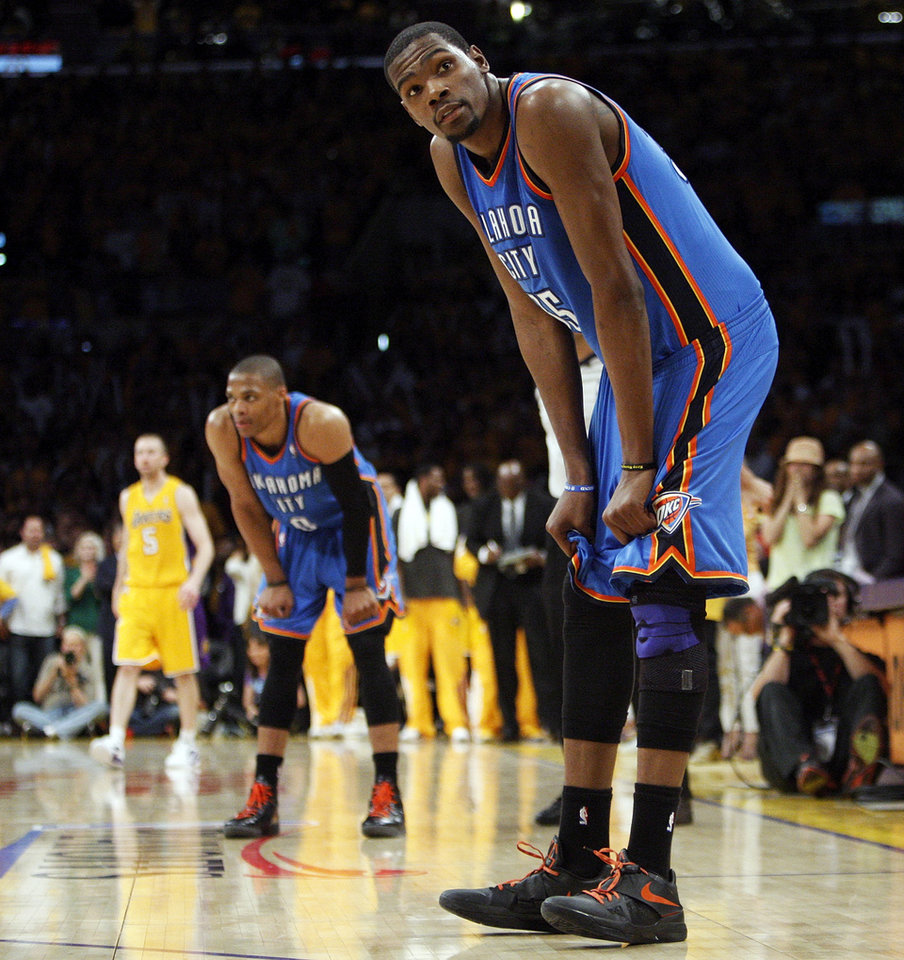 Photo - Oklahoma City's Kevin Durant (35) and Russell Westbrook (0) rest their hands on their knees late in the fourth quarter during Game 3 in the second round of the NBA basketball playoffs between the L.A. Lakers and the Oklahoma City Thunder at the Staples Center in Los Angeles, Friday, May 18, 2012. Photo by Nate Billings, The Oklahoman