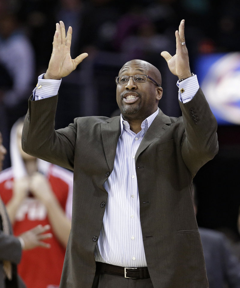 Photo - Cleveland Cavaliers head coach Mike Brown gestures during the fourth quarter of an NBA basketball game against the Indiana Pacers, Sunday, Jan. 5, 2014, in Cleveland. The Pacers won 82-78. (AP Photo/Tony Dejak)