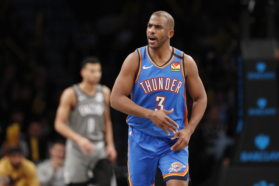 Photo - Oklahoma City Thunder guard Chris Paul (3) reacts after hitting a three-point shot during the second half of an NBA basketball game against the Brooklyn Nets, Tuesday, Jan. 7, 2020, in New York. The Thunder defeated the Nets 111-103 in overtime. (AP Photo/Kathy Willens)