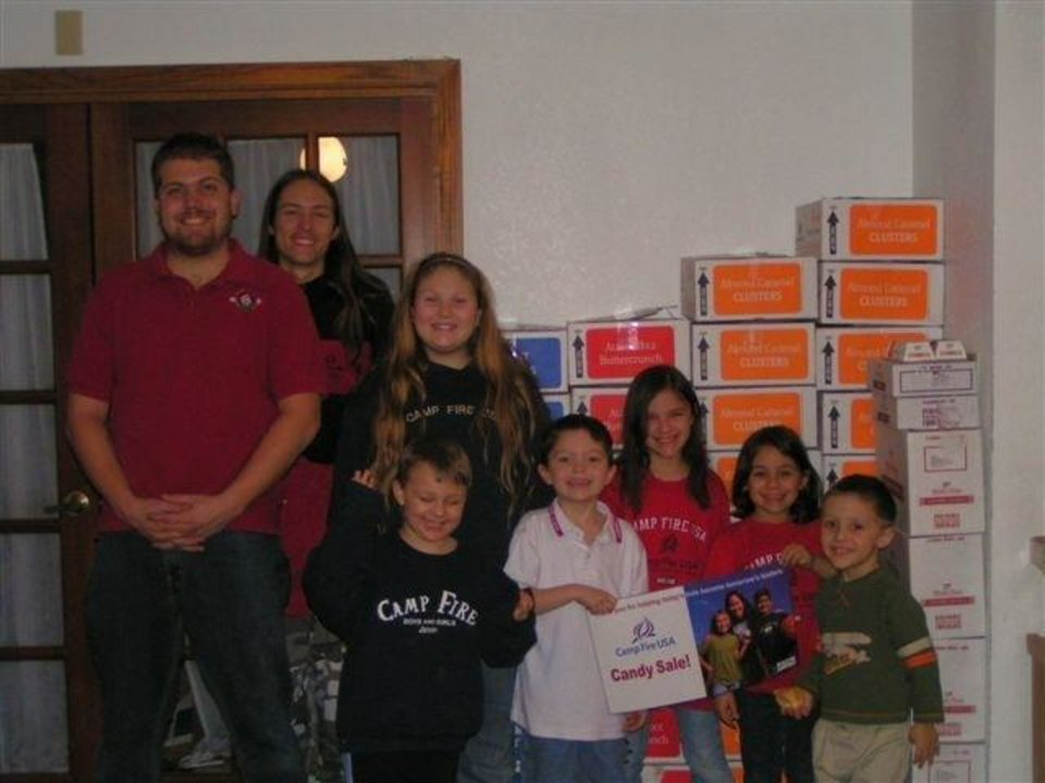 The family of Jim and Carolyn Herman are celebrating three generations and 20 years of selling Camp Fire USA Candy.  Pictured are Casey, Justin, Erica, Caleb (Casey's son), Curtis, Brandy, Melissa and Gregory<br/><b>Community Photo By:</b> Jim Herman<br/><b>Submitted By:</b> Keri, Oklahoma City