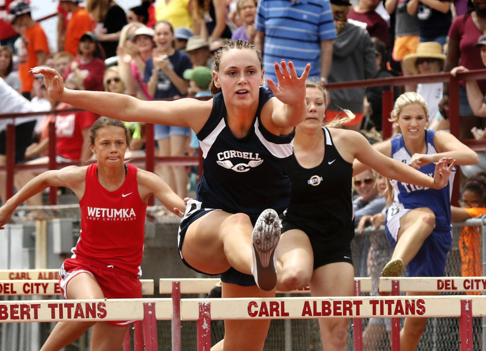 Photo - Mckenna (cq on the lineup) Morley of Cordell High School posts a 14.97 time to win Class 2A 100 meter hurdles event. Class A-2A boys and girls state championship track meet at Carl Albert High School on Saturday, May 7. Photo by Jim Beckel, The Oklahoman.
