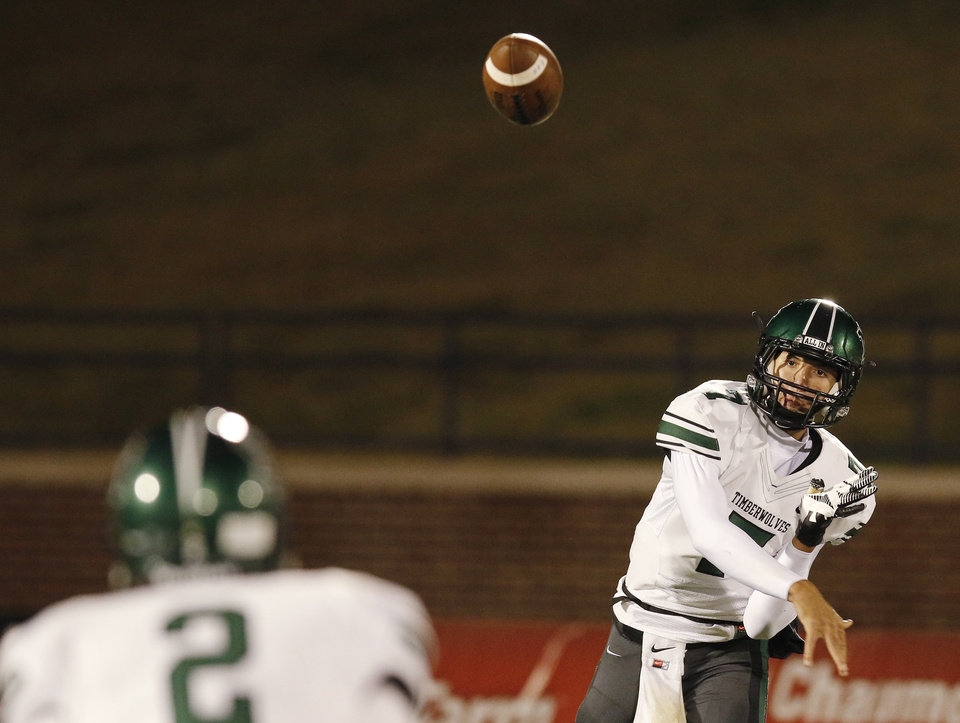 NN#7 John Kolar passes to #2 Maguire Perrett during the high school football game between Norman North and Edmond North in Edmond at Wantland Stadium Friday, Friday, October 18, 2013.  Photo by Doug Hoke, The Oklahoman