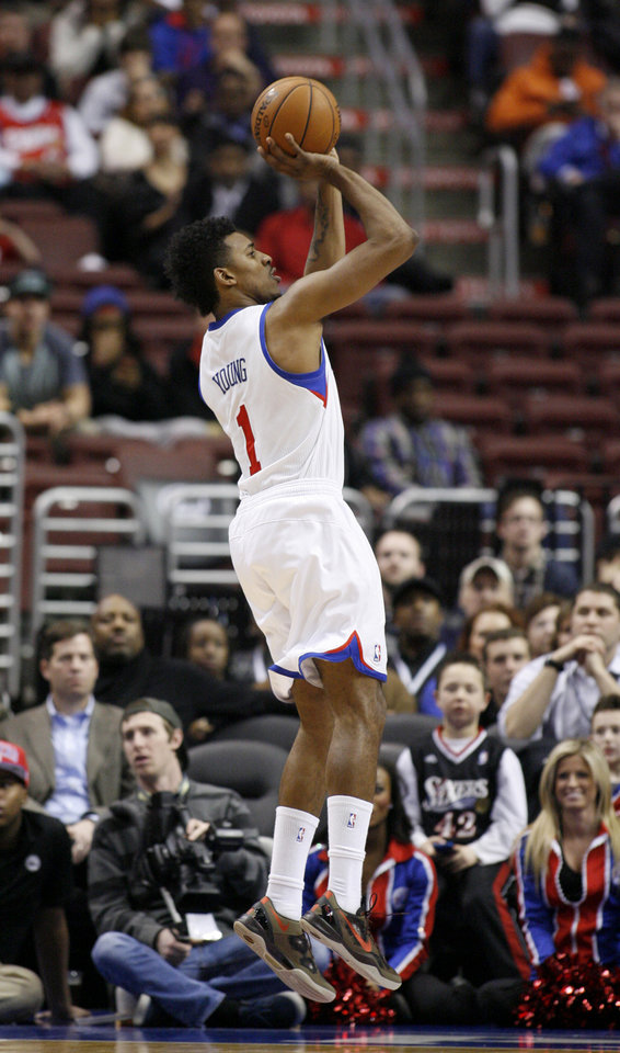 Photo - Philadelphia 76ers' Nick Young (1) shoots against the Los Angeles Clippers in the first half of an NBA basketball game, Monday, Feb. 11, 2013, in Philadelphia. (AP Photo/H. Rumph Jr)