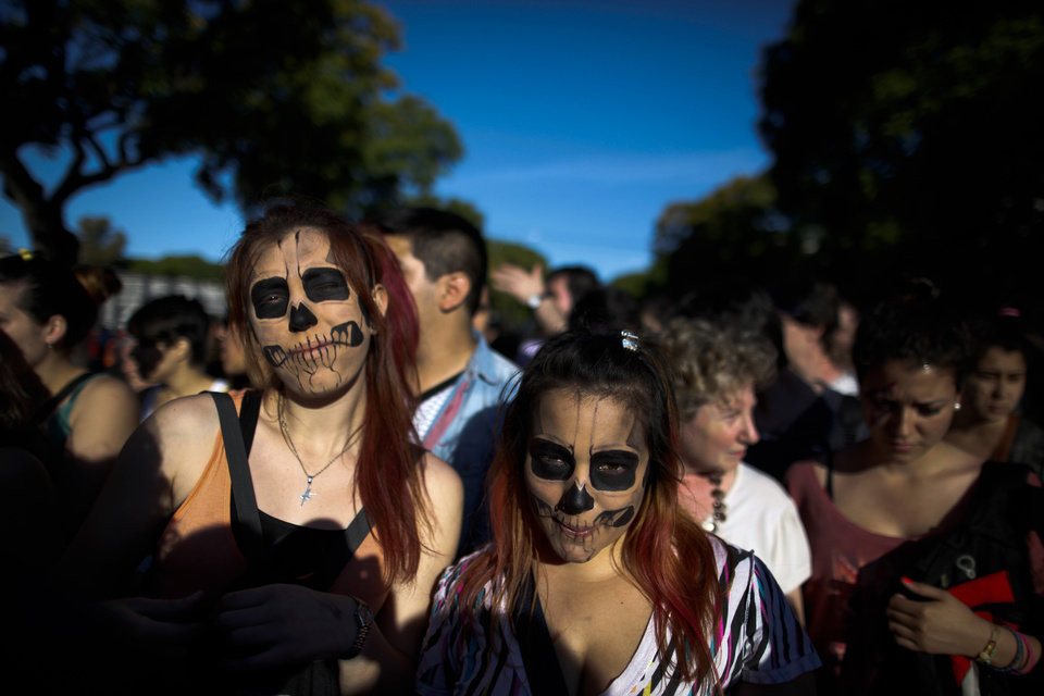 Photo -   Lady Gaga fans wait to enter the stadium where the U.S. pop star will perform a concert, in Buenos Aires, Argentina, Friday, Nov. 16, 2012. The Latin American leg of her,