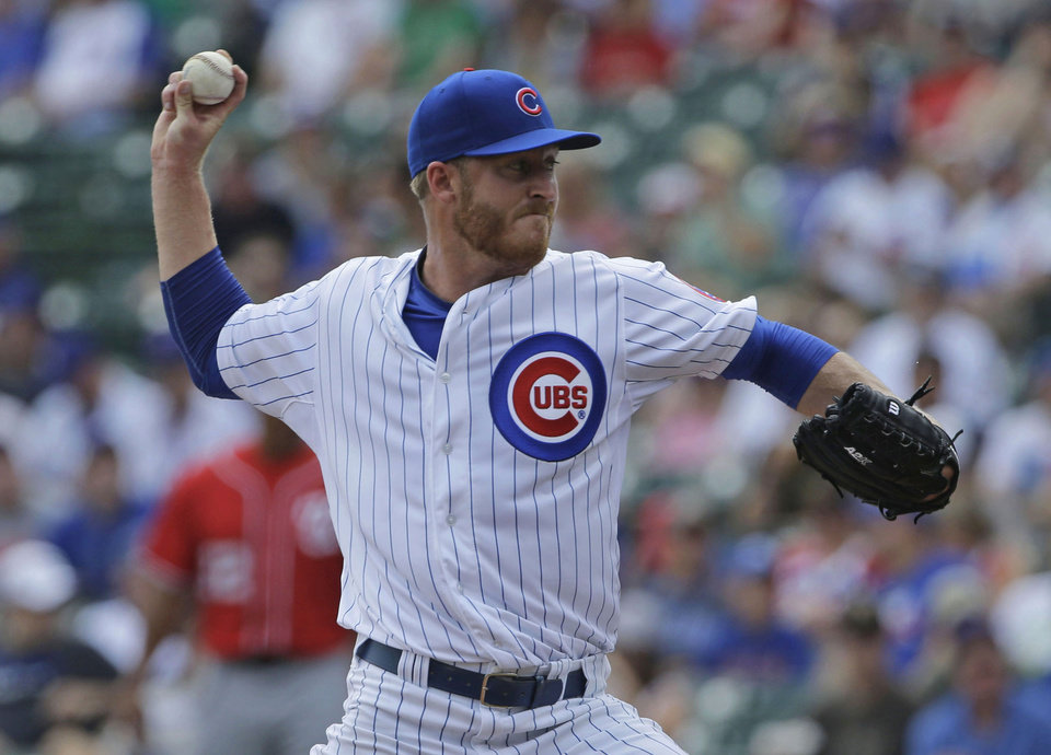Photo - Chicago Cubs starter Dallas Beeler throws against the Washington Nationals during the first inning of a baseball game in Chicago, Saturday, June 28, 2014.  (AP Photo/Nam Y. Huh)
