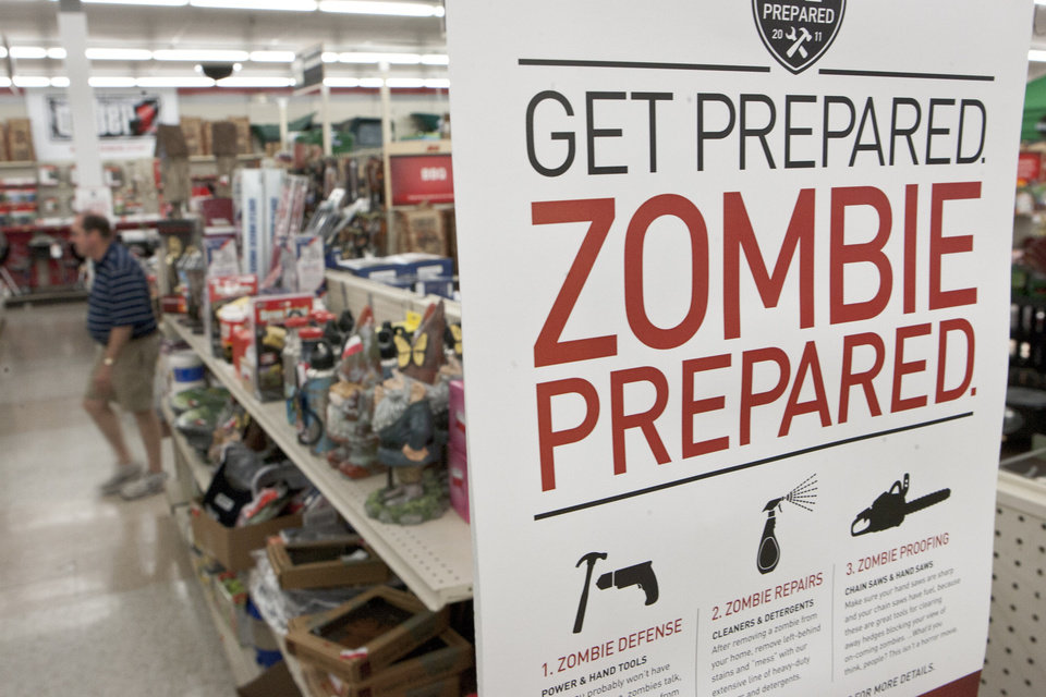 "A sign promoting zombie preparadness is seen in a hardware store in Omaha, Neb., Monday, Oct. 10, 2011. The Westlake Ace hardware chain with stores in seven states is offering tips on how to ""zombie-proof"" your house. The store is advertising nail guns and chain saws for ""zombie defense,"" and one part of a Q-and-A section asks: ""A zombie fell and put a hole in my drywall. What tools will I need to fix this?""(AP Photo/Nati Harnik)"