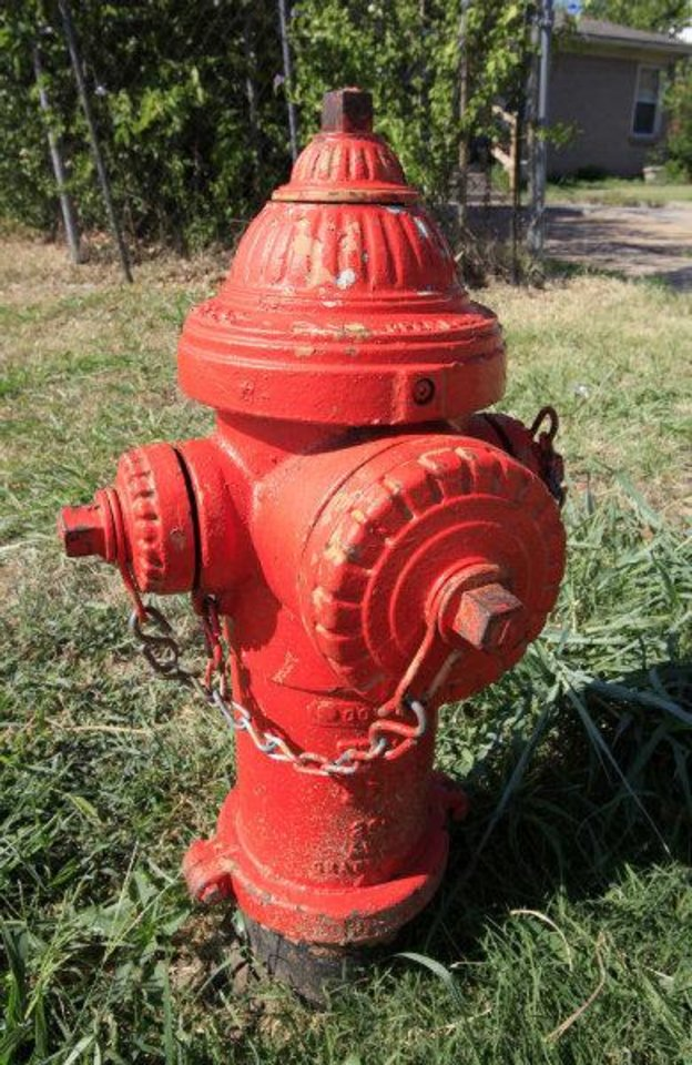 Photo - This fire hydrant on the corner of NW 88 and Shartel Avenue failed last month leaving firefighters scrambling to locate another as a nearby house burned in Oklahoma City.  PAUL B. SOUTHERLAND - PAUL B. SOUTHERLAND