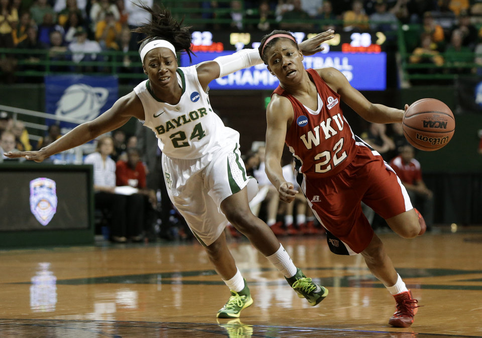 Photo - Baylor's Ieshia Small (24) gives chase as Western Kentucky's Bianca McGee (22) drives to the basket in the first half of a first-round game in the NCAA women's college basketball tournament, Saturday, March 22, 2014, in Waco, Texas. (AP Photo/Tony Gutierrez)