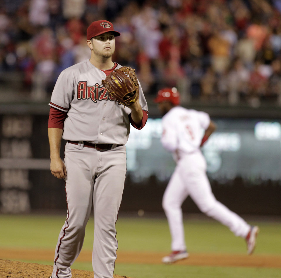 Photo - Arizona Diamondbacks Evan Marshall waits for a new ball after Philadelphia Phillies' Domonic Brown hit a two run home run in the seventh inning of a baseball game on Friday, July 25, 2014, in Philadelphia. The Phillies won 9-5. (AP Photo/H. Rumph Jr)