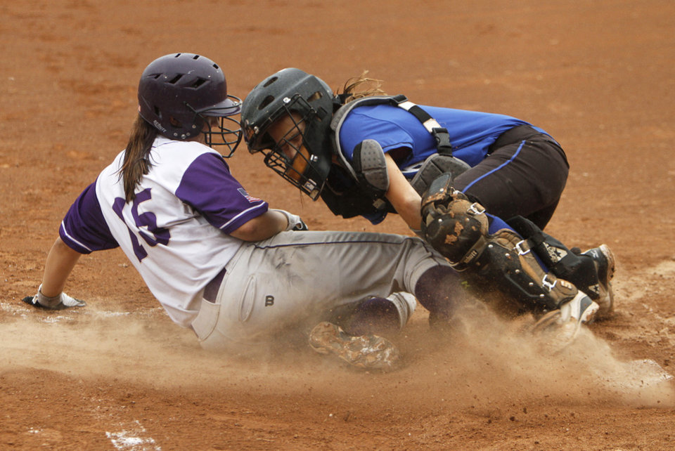 Chickasha\'s (15) slides into home past Deer Creek\'s Kennedy Turner (11) during a 5A state softball semifinals game between Edmond North and Yukon at ASA Hall of Fame Stadium in Oklahoma City, Okla., Friday, Oct. 12, 2012. Photo by Garett Fisbeck, The Oklahoman