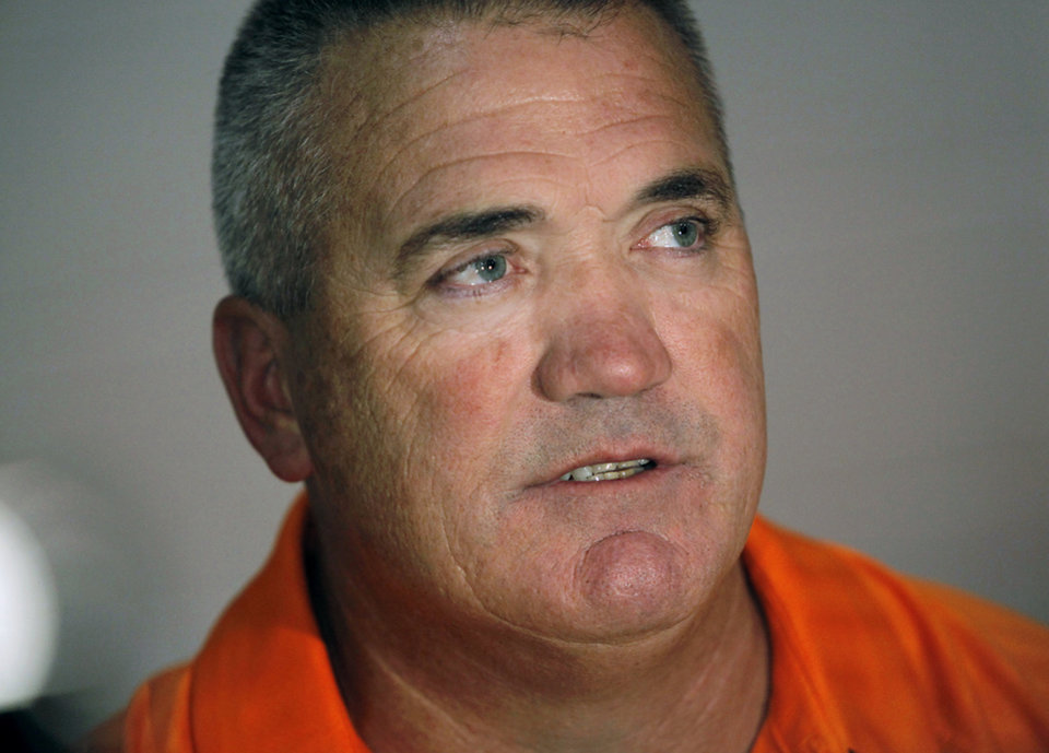 Photo - OSU Offensive Line Coach Joe Wickline speaks to the media during Media Day at Gallagher-Iba Arena on the Oklahoma State University campus in Stillwater on Saturday, Aug. 6, 2011. Photo by John Clanton, The Oklahoman