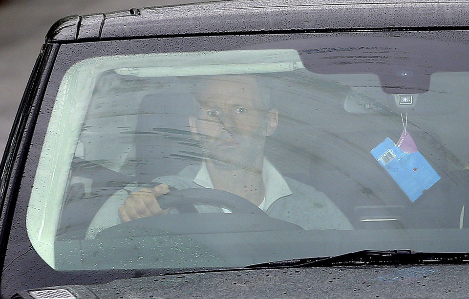 Photo - Manchester United's Ryan Giggs arrives at the clubs' Training Complex, Carrington, Manchester, England Tuesday April 22, 2014. Manchester United says manager David Moyes has left the Premier League club after less than a year in charge, amid heavy speculation he was about to be fired. United released a brief statement in its website Tuesday, saying the club