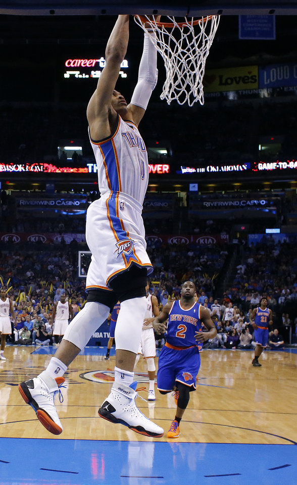 Oklahoma City\'s Russell Westbrook (0) dunks the ball in front of New YorK\'s Raymond Felton (2) during NBA basketball game between the Oklahoma City Thunder and the New York Knicks at the Chesapeake Energy Arena, Sunday, April 7, 2010, in Oklahoma City Photo by Sarah Phipps, The Oklahoman