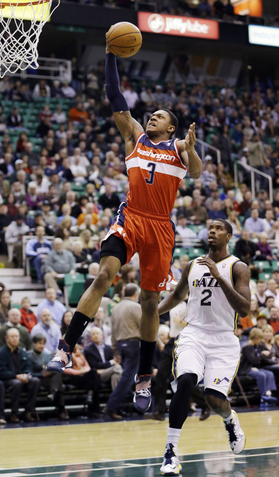 Photo - Washington Wizards' Bradley Beal (3) goes to the basket as Utah Jazz's Marvin Williams (2) watches during the first quarter of an NBA basketball game, Wednesday, Jan. 23, 2013, in Salt Lake City. (AP Photo/Rick Bowmer)