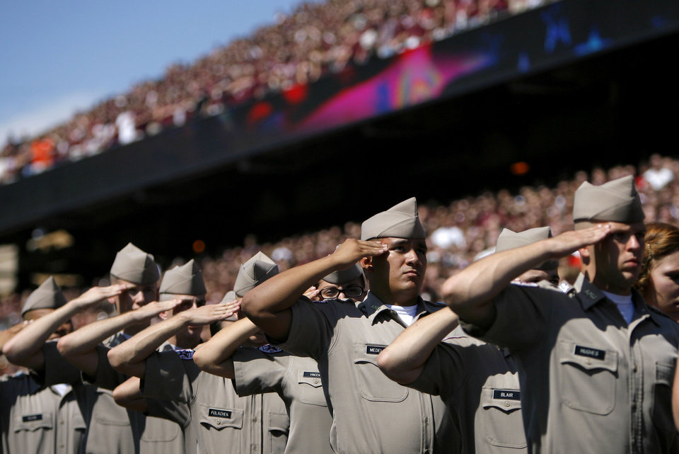 Texas A&M Corps of Cadets salutes in the first half Saturday. Photo by Sarah Phipps, The Oklahoman