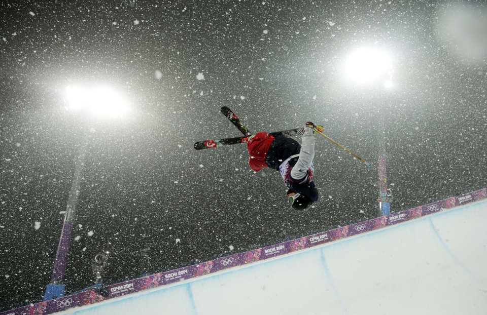 Photo - Aaron Blunck of the United States gets air during the men's ski halfpipe final at the Rosa Khutor Extreme Park, at the 2014 Winter Olympics, Tuesday, Feb. 18, 2014, in Krasnaya Polyana, Russia. (AP Photo/Andy Wong)