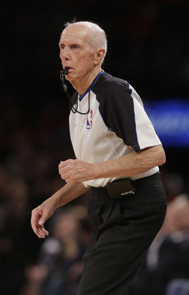 Photo - Referee Dick Bavetta   works during the first half of an NBA basketball game between the New York Knicks and the Brooklyn Nets Wednesday, April 2, 2014, in New York.    Bavetta worked his 2,633rd consecutive game assignment Wednesday, an ironman streak even longer than the one baseball Hall of Famer Cal Ripken Jr. compiled.  The Knicks won the game 110-81.  (AP Photo/Frank Franklin II)