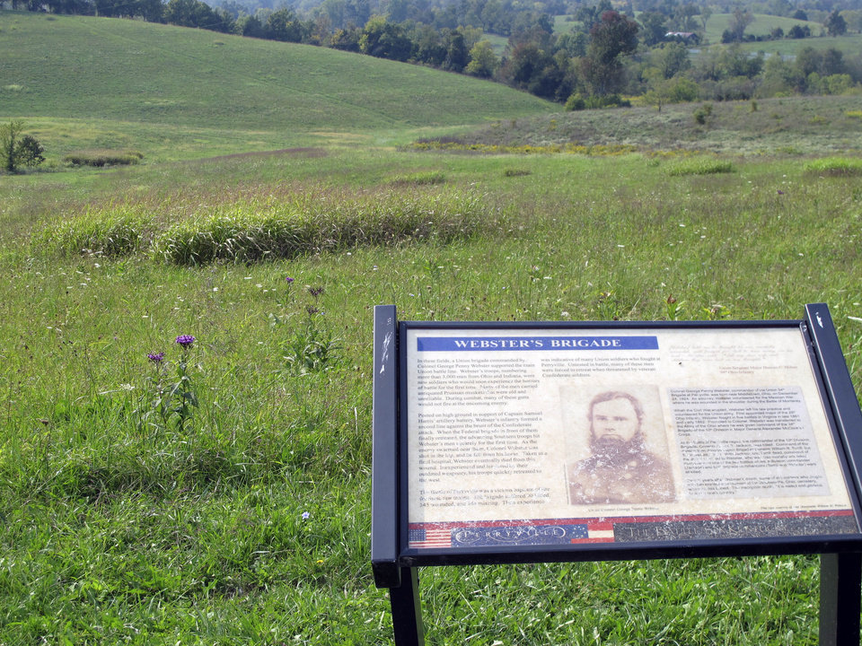 This Sept. 26, 2012 photo shows a marker positioned at the site of a Civil War battlefield near Perryville, Ky., where Union Col. George Penny Webster fought and died. Webster\'s great-grandson, former FBI and CIA director William Webster, says his ancestor has always been one of his heroes because of his sense of responsibility. (AP Photo/Bruce Schreiner)