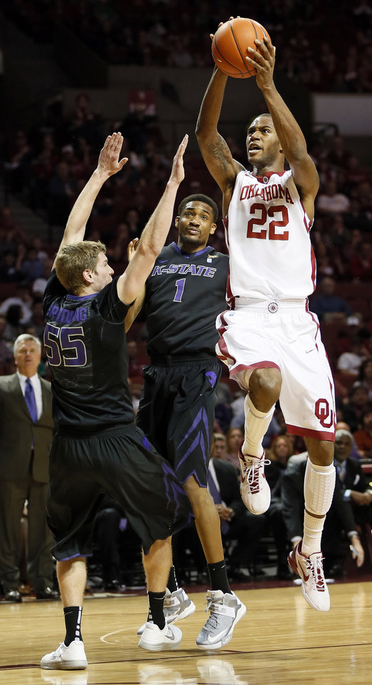 Photo - Oklahoma's Amath M'Baye (22) shoots against Kansas State's Will Spradling (55) and Shane Southwell (1) during an NCAA men's basketball game between the University of Oklahoma (OU) and Kansas State at the Lloyd Noble Center in Norman, Okla., Saturday, Feb. 2, 2013. Photo by Nate Billings, The Oklahoman