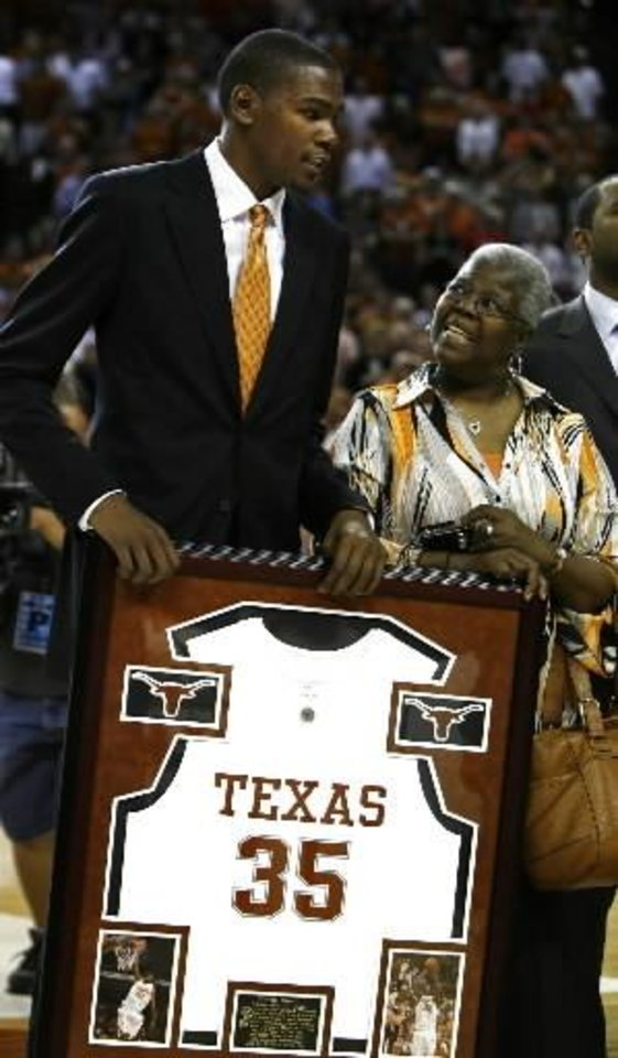 Former Texas basketball player and 2006-2007 National Player of the Year  Kevin  Durant stands with his grandmother Barbara Davis during a halftime ceremony in which Texas officially retired  Durant's No. 35 jersey during an NCAA college basketball game against Texas Tech in Austin, Texas, Wednesday, Feb. 25, 2009.  Durant now plays for the NBA's Oklahoma City Thunder. (AP Photo/Erich Schlegel)